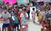 Diocese of the Philippines and Vietnam organises hot meals for underprivileged children in Bacoor