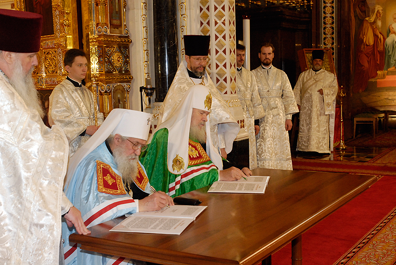 Signing the Act of Canonical Communion by Late Patriarch Alexy of Moscow and All Russia and late Metropolitan Larus, First Hierarch of the Russian Orthodox Church Outside Russia.