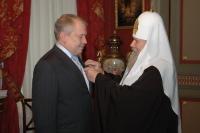 Святейший Патриарх Алексий вручил руководителю Федерального агентства по государственным резервам церковную награду